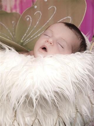 Sleeping newborn girl Irish pixie