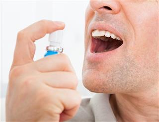 Man applying Fresh breath spray???