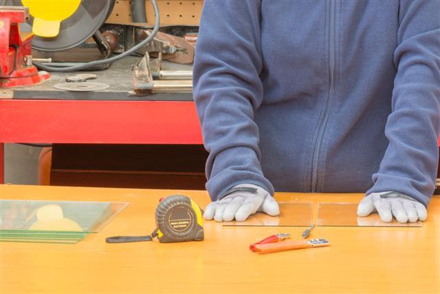 worker cutting glass