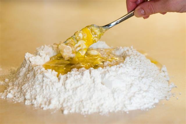 pour the wet mixture in flour