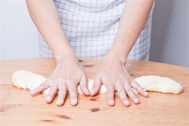 Roll dough piece into a long coil