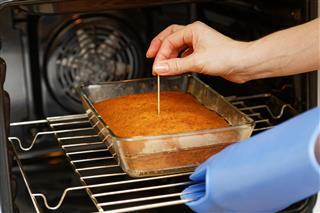 Cook Checking Cake