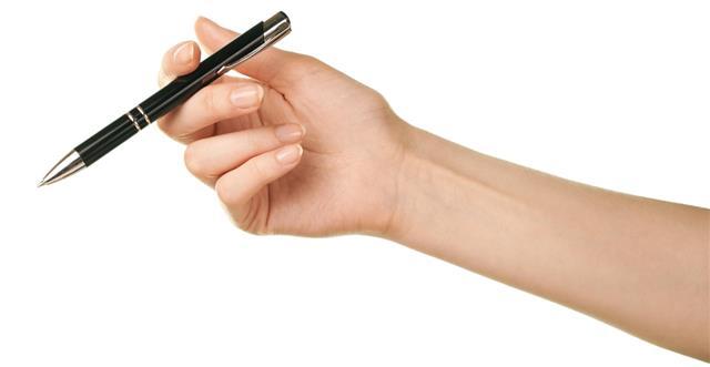 Female caucasian handholding pen