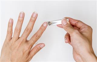 woman cut fingernail