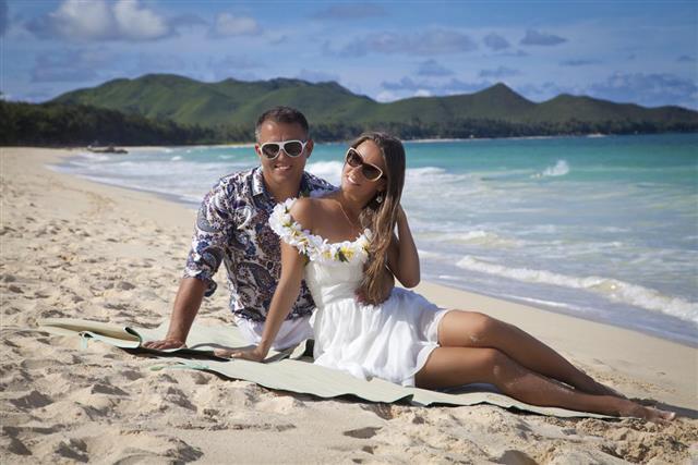 Romantic Couple, sitting on the beach