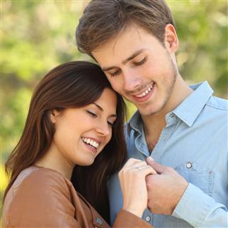 Man holding woman hand in garden
