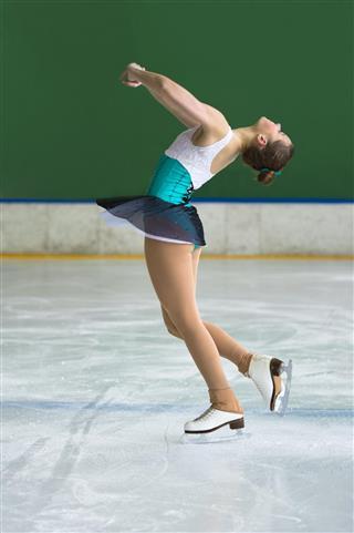 Beautiful young women performing pirouette