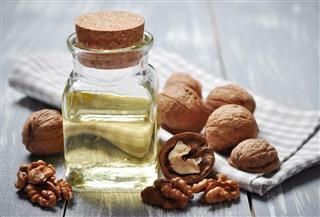 Walnut oil jar with nuts