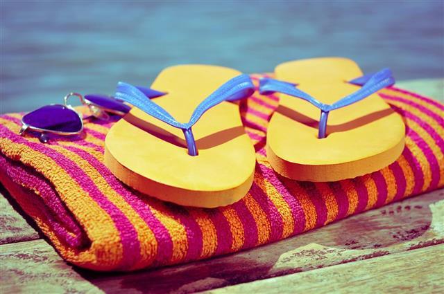 Sunglasses, Slipper and Beach Towel