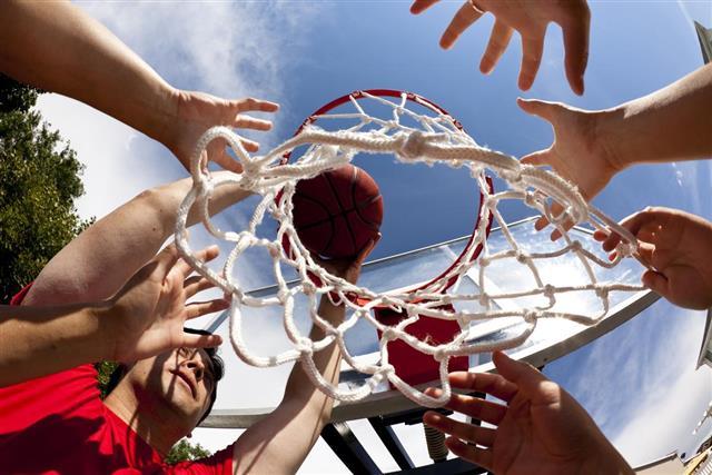 Hands on basketball goal