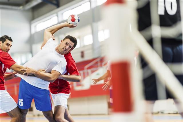 Handball player shooting at goal