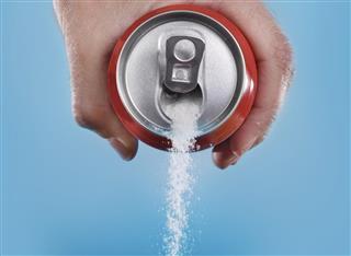 Hand holding soda