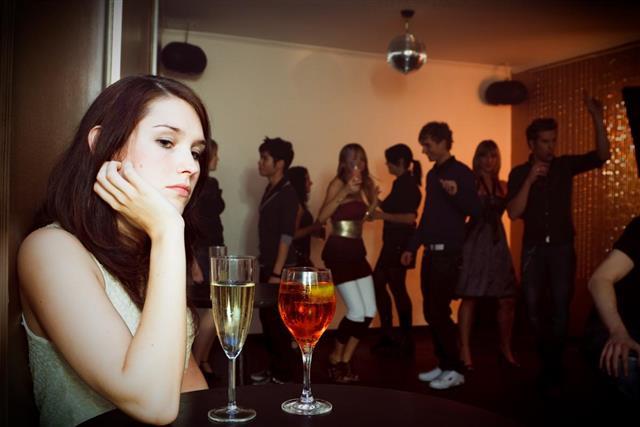 Woman sitting alone in nightclub
