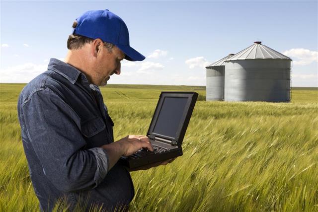 Farmer, Silos and a Computer