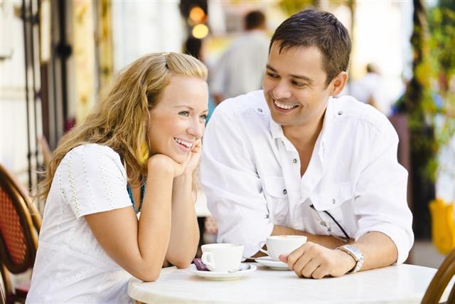 Happy couple having a coffee break