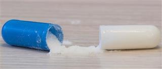 White medicine capsules probiotic powder inside