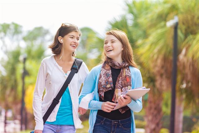 Cute young teens walking