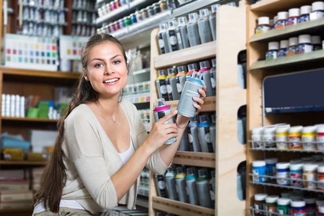 Woman shopping acrylic color spray