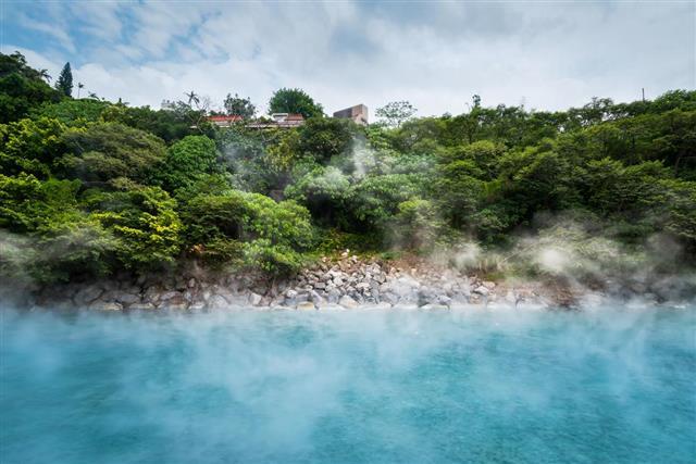 Blue hot spring pond in forest