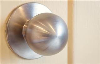 Handle of the door on wood background.