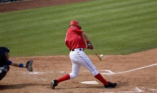 Baseball player hitting ball during a game