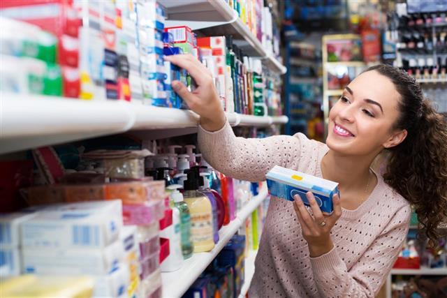 Female customer buying toothpaste