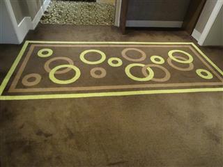 Hard-wearing, short cut-pile brown / yellow carpet, pattern