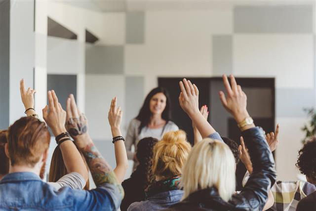 Student raising hands