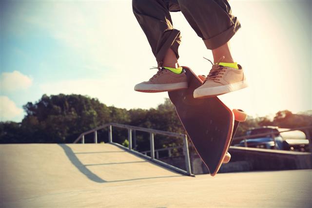 Skateboarder legs doing a trick heelflip