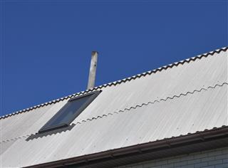 Dangerous asbestos new roof tiles with roof window, skylights