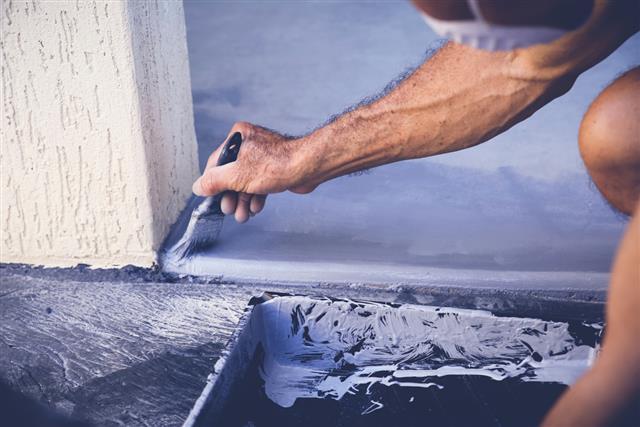 Hand painting garage floor, soft selective focus, toning