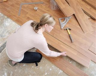 Woman Installing Laminate Flooring