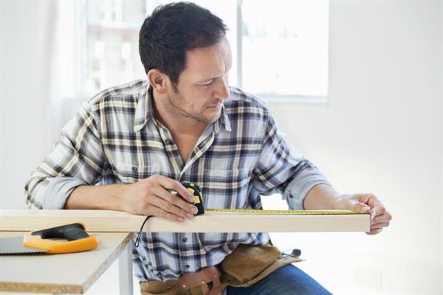 Carpenter Measuring Wooden