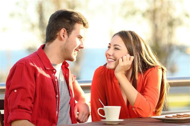 couple in love flirting in a terrace