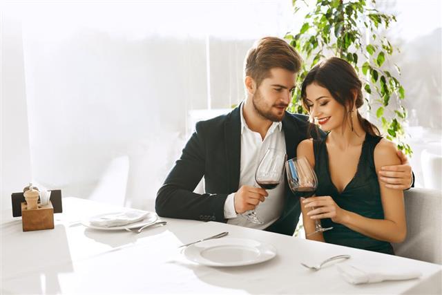 Couple In Love Having Romantic Dinner