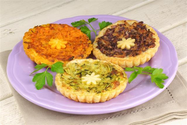Three mini vegetarian quiches