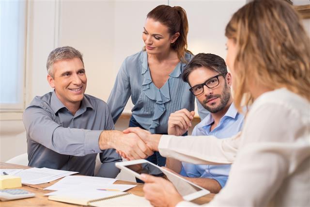 Business handshake during meeting