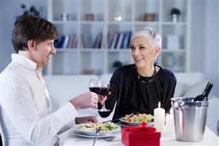 Beautiful mature, senior couple have romantic dinner