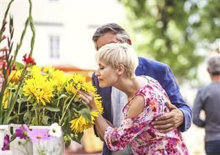 Senior couple at the flower market