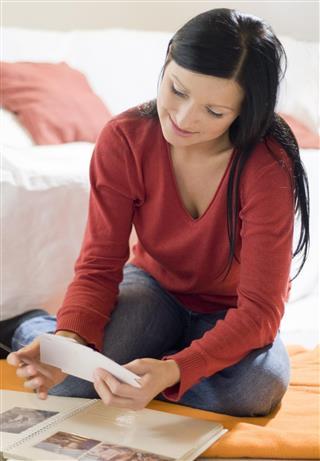 Woman making scrapbook