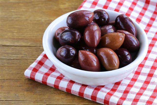 Ripe black olives in a white bowl