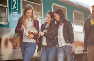 students reading magazines