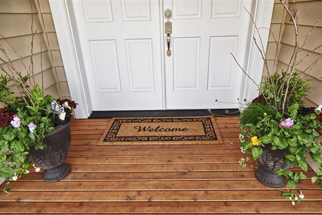 Welcome Home entrance double doorway flowers in pots