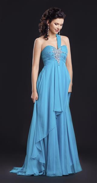 Graceful woman in classic long cyan dress posing