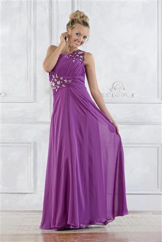 Beautiful woman in lilac long dress
