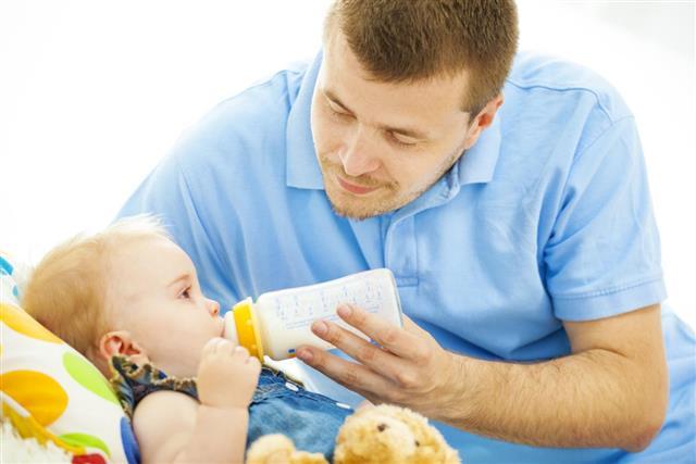Father feeding baby food