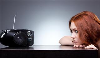 woman listening radio