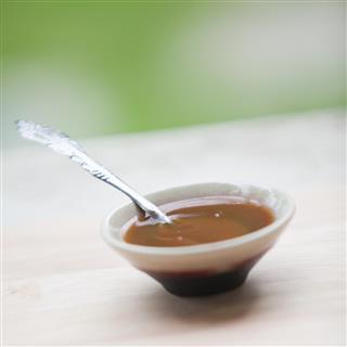 Tamarind Sauce, paste, juice, liquid in mini bowl.