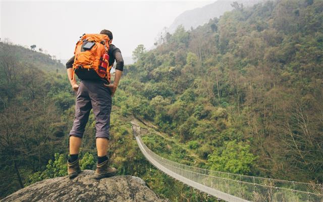 Hiker man standing on rock