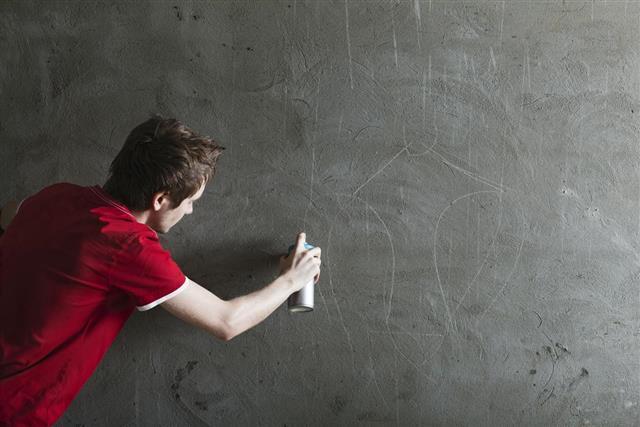 Graffiti artist with blank wall